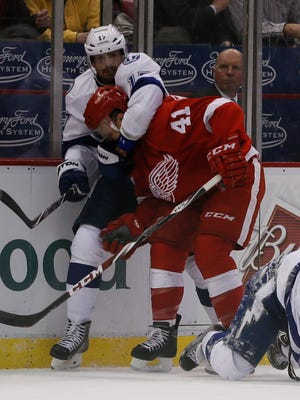 The Lightning's Alex Killorn and Red Wings forward Luke Glendening get into a scuffle in the third period of Thursday's Game 4 at Joe Louis Arena.