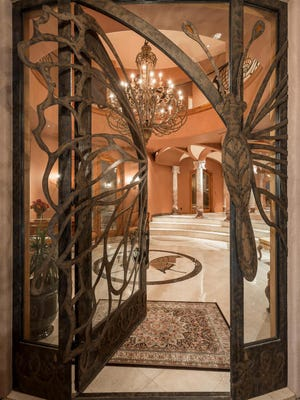 The home has soaring ceilings as high as 24 feet, two elevators, an 8-foot glass dome, 18 marble columns, French rococo gilded plaster walls and marble, porcelain and black walnut floors.