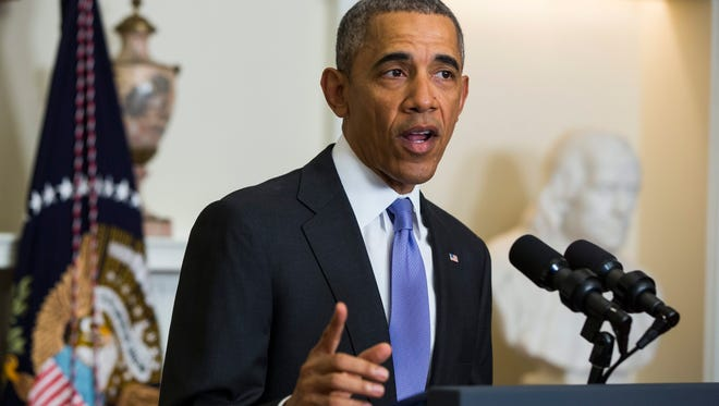 President Obama delivers a statement about the U.S. lifting economic sanctions on Iran in the Cabinet Room of the White House Sunday. Obama also spoke about the freed American hostages, and said that Iran 'will not get its hands on a nuclear bomb.'