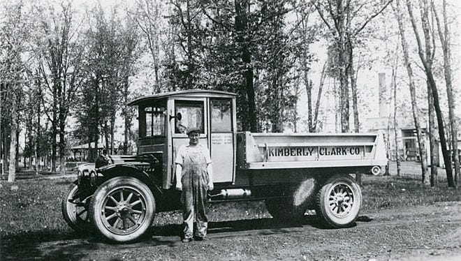 An unidentified driver stands in front of a Kimberly-Clark Corp. truck. The date of the photograph is unknown.