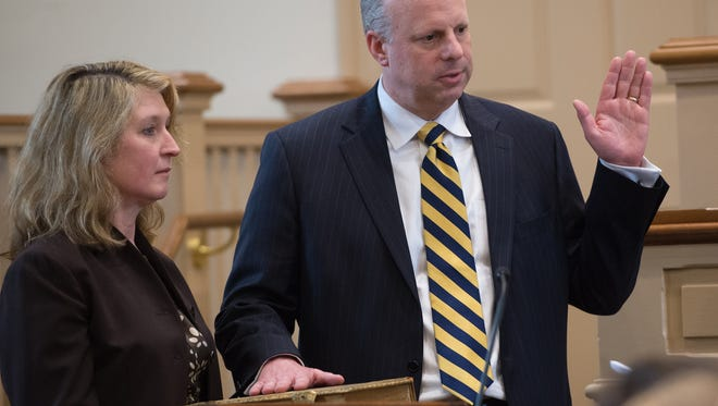 Vice Chancellor Joseph R. Slights III, center being sworn in by Leo E. Strine, Jr., Chief Justice, Supreme Court of Delware at the Kent County Courthouse in Dover as his wife Ellen W. Slights holds the Bible.