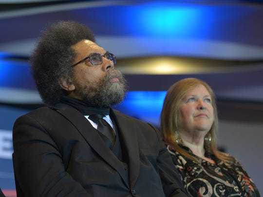 Cornel West, left, sits with Jane Sanders while Bernie