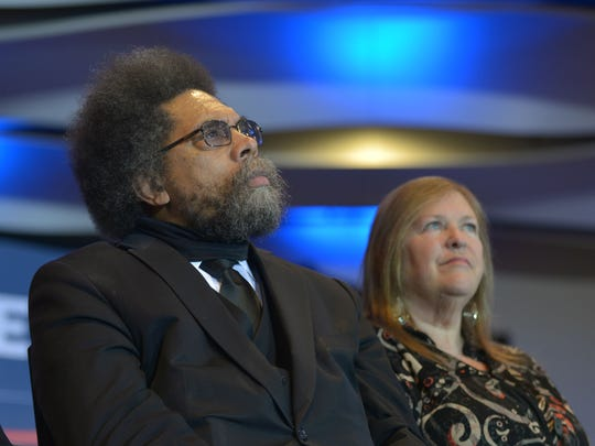 Cornel West, left, sits with Jane Sanders while Bernie Sanders speaks at a rally in Cedar Rapids, Iowa, on Saturday, January 30, 2016.