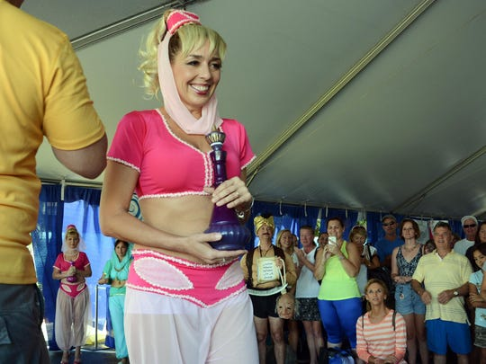 Smith takes her turn on stage during the Jeannie Look-alike contest as part of the 2015 Ron Jon Cocoa Beach Half Marathon.