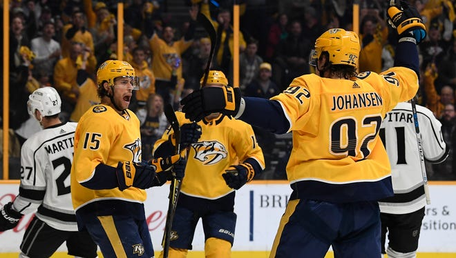 Predators center Craig Smith (15) celebrates his goal with teammates during the first period of their game against the Kings at Bridgestone Arena in Nashville, Tenn., Thursday, Feb. 1, 2018.