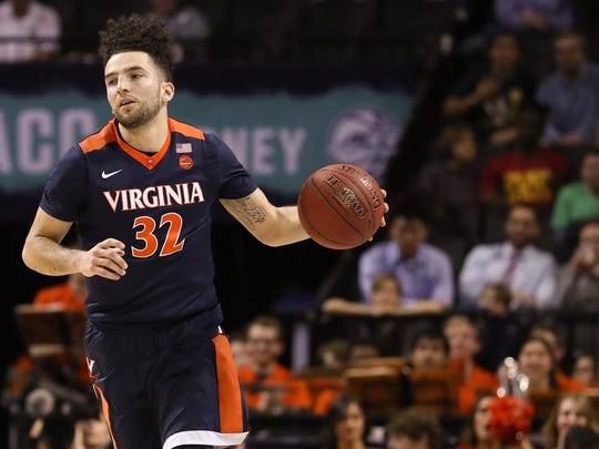 Virginia Cavaliers guard London Perrantes (32) dribbles the ball during the first half against the Notre Dame Fighting Irish during the ACC Conference Tournament at Barclays Center.