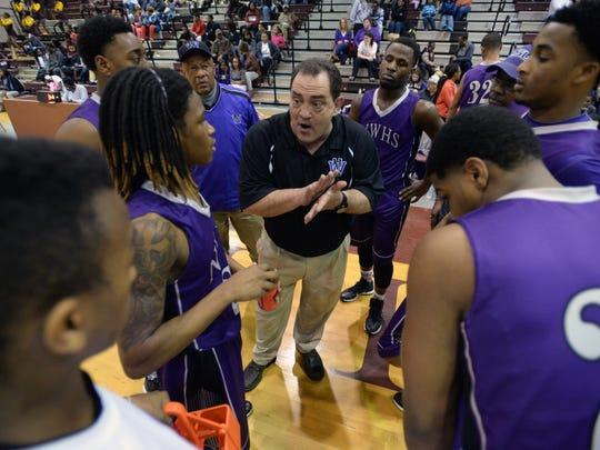 North Webster head coach Rodney Thrash talks to his