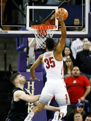Arizona's Allonzo Trier dunks over the Washington defense
