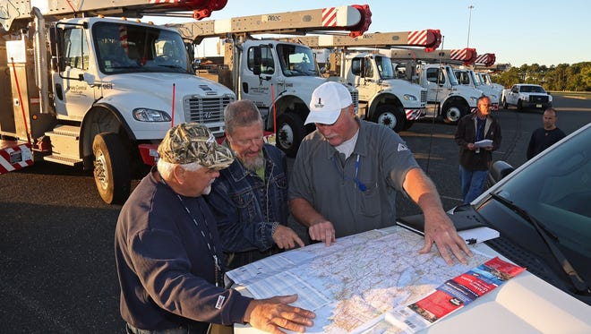 Jersey Central Power & Light employees (L to R) Tom Bodine, Joe Ribas and Ed France look over a map of the Eastern United States as they prepare to lead JCP&L crews south from FirstEnergy Park in Lakewood in support of Hurricane Irma restoration efforts.