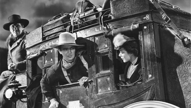 """John Wayne, center, appears in a scene from the 1939 classic Western """"Stagecoach,"""" the film that established him as a star."""