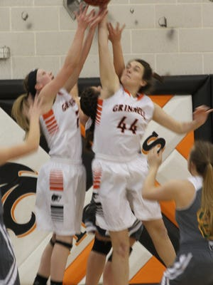 Grinnell's Macy Harris, 2, and Katie Cooper, 44, go after a rebound during Grinnell's 74-33 win in the Class 4A-Region 7 victory at home on Saturday, Feb. 18.