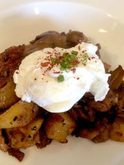 Poached egg on hash at ArtsRiot on Pine Street in Burlington.