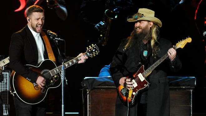 Justin Timberlake performs with Chris Stapleton at the 49th annual CMA Awards on Wednesday in Nashville.