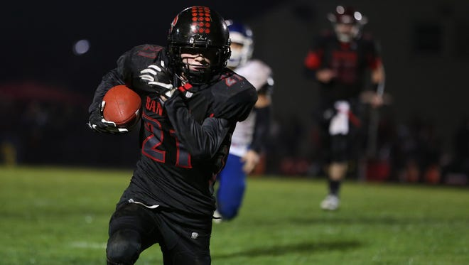 Santiam's Jordan Lanham runs the ball as the Wolverines take on St. Paul in a Tri-River Conference game on Friday, Oct. 7, 2016, at Santiam High School in Mill City.