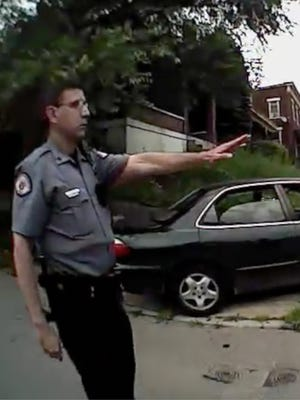 A UCPD officer tells Ray Tensing to step away from Samuel DuBose's car.