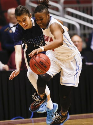 Phoenix South Mountain's Ozahria Fisher battles for ball control with Tucson Pueblo Magnet's Larissa Varela in the Division III girls basketball state tournament quarterfinals on Thursday at Gila River Arena.