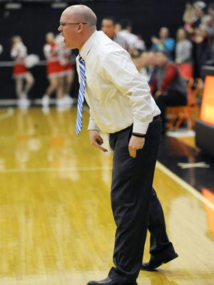 Jeran Cox is shown coaching on the sidelines during a tournament contest in 2015. Cox resigned from his position Thursday after three years with the Panthers.
