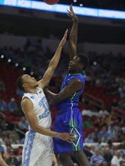 FGCU's Demetris Morant shoots over North Carolina's Brice Johnson during the first round of the NCAA tournament, March 17, 2016, at PNC Arena in Raleigh, North Carolina.