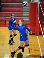 Southeastern's Ella Skeens attacks the volleyball this