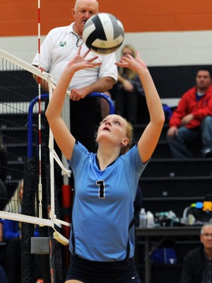 Adena's Lanie Shea assists a kill against South Point at Waverly High School, Oct. 28, 2015. Shea returns as one of the area's top setters this fall.