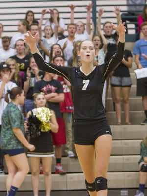 Desert Hills' Rachel Winters celebrates after scoring a point. Winters had 380 kills last year and is expected to have another big year for the Thunder this season.