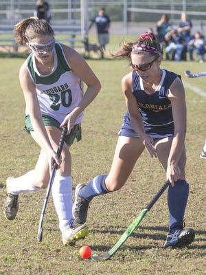 Field hockey Freehold Boro at Colts Neck. Colts Neck #20 Madison Bellows (left) and Boro #2 Gabby Arancio fight for the ball—October 6, 2016-Colts Neck, NJ.