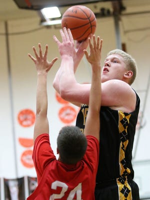 Paint Valley's Dylan Swingle shoots over Westfall's Noah Aponte during a Division III sectional final contest at Waverly's Downtown Gym. Swingle earned a first-team all-Ohio nod Tuesday.
