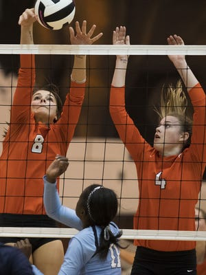 Mauldin's Jenna Moore (8) and Riley Whitesides (4) attempt to block  the ball during Dorman's 3-0 victory in Tuesday night's Class AAAAA volleyball Upper State championship match.