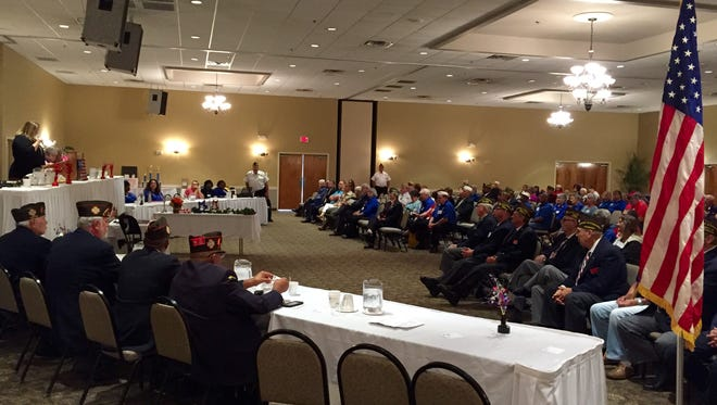 Attendees of the Louisiana Veterans of Foreign Wars state convention listen to a presentation in Alexandria Friday.