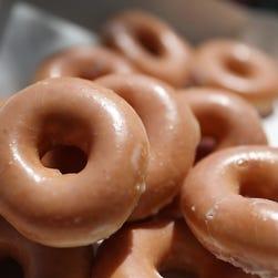 Eating Krispy Kreme Donuts got one man arrested, he said.