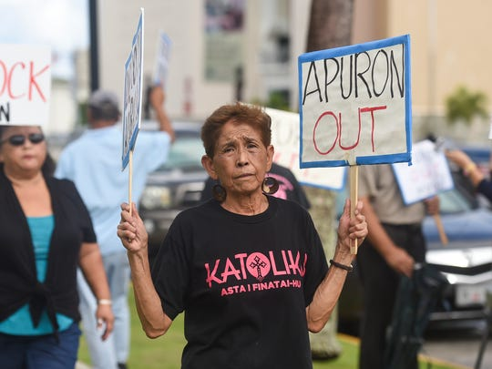 In this July 9, 2017, file photo, Doris Concepcion, whose late son Joseph A. Quinata alleged he was molested by Archbishop Anthony Apuron, participates in the a protest at the Dulce Nombre de Maria Cathedral-Basilica in Hagåtña.