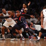 Atlanta Hawks power forward Paul Millsap (4) intercepts a pass from Brooklyn Nets small forward Thaddeus Young (30) to Brooklyn Nets small forward Joe Johnson (7) during the third quarter of game six of the first round of the NBA Playoffs at Barclays Center. The Hawks defeated the Nets 111-87 to win the series 4-2.