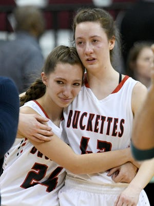 Buckeye Central's Kendra Stahl and Elizabeth Heydinger console one another after the Buckettes were defeated by Ottoville on Thursday in Columbus.