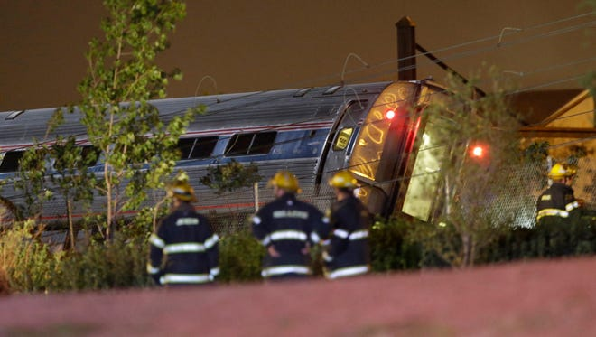 Emergency personnel work at the scene of an accident after an Amtrak train headed to New York City derailed and crashed near Philadelphia in May.