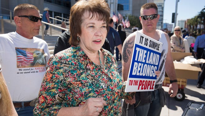 Carol Bundy, wife of Nevada rancher Cliven Bundy,  speaks to reporters in front of the U.S. Courthouse in downtown Las Vegas Thursday, March 10, 2016. Cliven Bundy is facing charges that he led an armed standoff against federal agents two years ago.