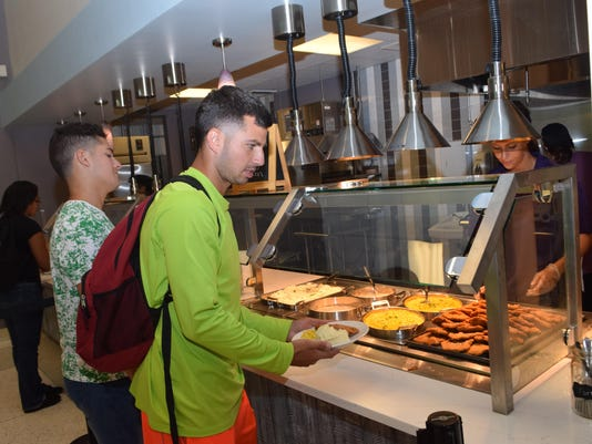 ANI Magnolia Cafe LSUA freshman business majors Alvaro Navarro (far left) and Gaven Stelly order food from the new Magnolia Cafe located in the student center on campus. -Melinda Martinez/The Town Talk
