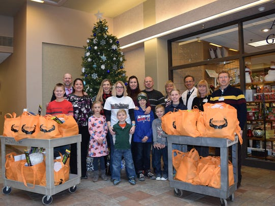 "Hardel's HOPE and the Hardel family and friends donated 100 ""HOPE"" gift bags for patients who were hospitalized at Aspirus Wausau Hospital during the Holidays. Patients and their families received a special visit and gift of ""HOPE,"" which stands for ""Help Offer Prayer and Encouragement."" Their special gifts included devotionals, snacks, activity books, lotions/lip balm, and other essentials to let them know they are not alone and that people care about them. Please visit the Hardel's HOPE Facebook page for more information and photos. Pictured are Eli Gustafson, front row from left, Jen Nieuwenhuis Hardel, Carmen Ghidorzi, Jenna Drews, Jace Drews, Marcus MacDonald, Jaxson MacDonald and Jaiden Drews; Jeff Hardel, back row from left, Margaret Ghidorzi, Jamie MacDonald, Brad MacDonald, Kim Boesl, RN, Fernando Riveron, MD, Kris Rabenold, RN, and Bill Wessels, MD."