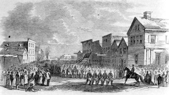 Image from Frank Leslie's illustrated newspaper depicting national troops marching through occupied Fernandina.