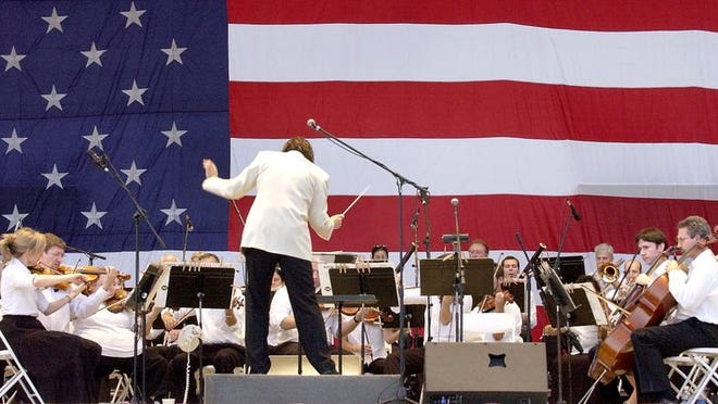 Maestro Mariusz Smolij leading the Acadiana Symphony Orchesrta in its Fourth of July concert in downtown Lafayette.