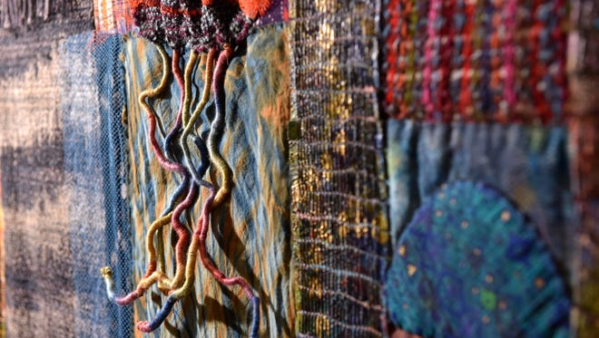 This is a mixed-media wall piece that incorporates Boisaili's weaving and hand-dyed fabrics.