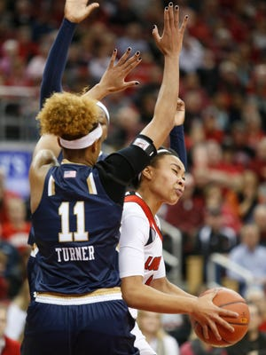 Louisville's Mariya Moore is fouled by Notre Dame's Brianna Turner while attempt a shot late in the first half. Feb. 7, 2016.