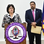 "Attorney General Elizabeth Barrett-Anderson, left, delegates Chief Prosecutor Philip Tydingco, right, to procure an independent prosecutor to investigate illegal Adelup pay raises in Tamuning on Feb. 11. In his address, Tydingco stated, ""The final contract must be executed by the governor, under Guam law."""
