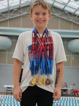Mountain Home's Ajay Reiss won high-point honors in the boys' 10-and-under division at the Winter All-Star swim meet for the Hurricanes.