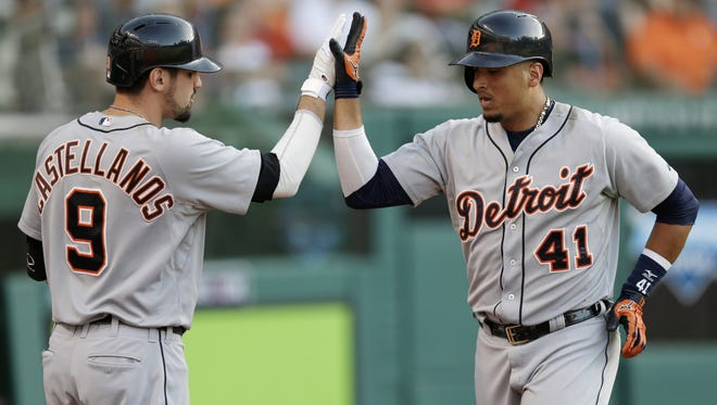 Detroit Tigers slugger Victor Martinez, right, is congratulated by Nick Castellanos after Martinez hit a solo home run against the Cleveland Indians on June 21, 2014, in Cleveland.