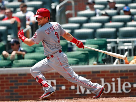 Cincinnati Reds second baseman Scooter Gennett (3) drives in a run with a base hit in the seventh inning of a baseball game against the Atlanta Braves Wednesday, June 27, 2018, in Atlanta. The Reds defeated the Braves 6-5. (AP Photo/John Bazemore)