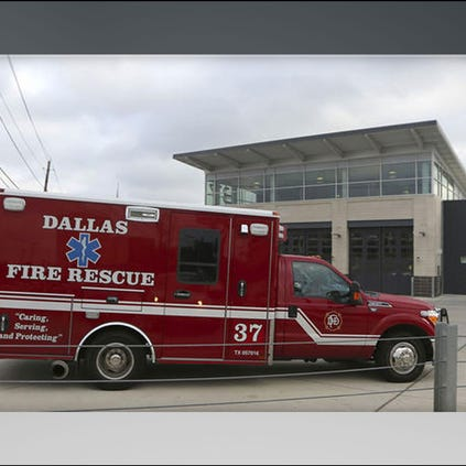 An ambulance pulls into the Dallas Fire-Rescue station 37 in Dallas, Wednesday, Oct. 1, 2014. Three EMT's from this location are under a 21-day quarantine after a patient they transported tested positive for Ebola.
