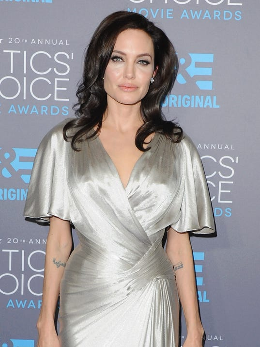 descriptive essay about angelina jolie Whenever angelina jolie makes a decision about ways that she will try to keep her own time bomb from going off, it lights my fuse.