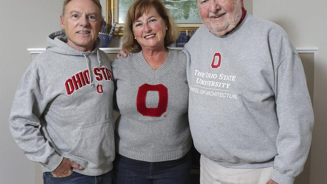 Paige Ramsey Squires's family has five generations of Buckeyes dating to the early 1900s. Paige poses for a portrait with her brother, Marc Ramsey, left, and her father, Dean Ramsey.