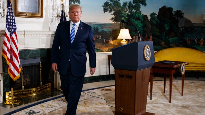 President Donald Trump walks away from the podium after delivering a statement on the Iran nuclear deal Tuesday at the White House.