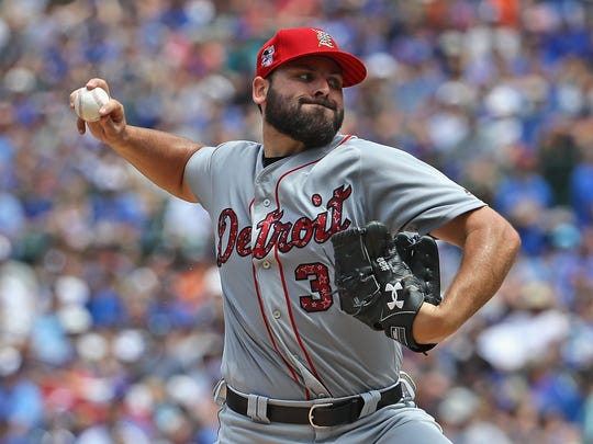 Starting pitcher Michael Fulmer #32 of the Detroit Tigers delivers the ball against the Chicago Cubs at Wrigley Field on July 3, 2018 in Chicago, Illinois.